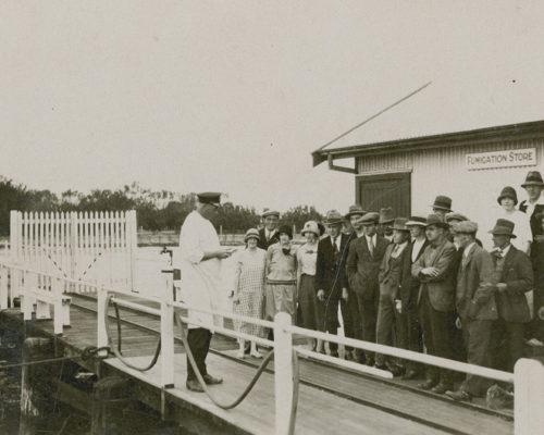 Passengers lining up at the Quarantine Station