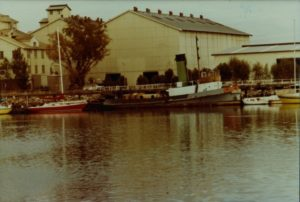 Yelta outside the CSR Refinery. The tug can be seen here painted many colours, occurring after its retirement. (Post 1977).
